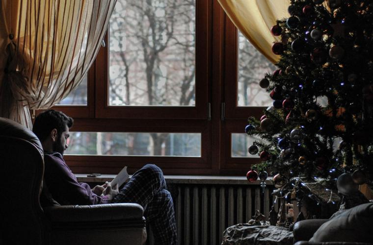 A resident at a care home sits by the window