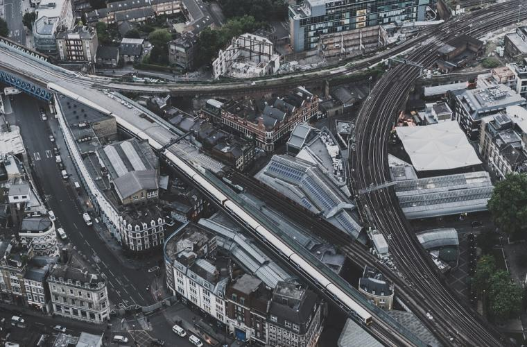 Ariel shot of trainline running through a city