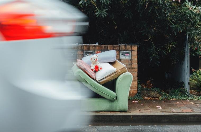 photo of flytipping - sofa and toys by side of the road