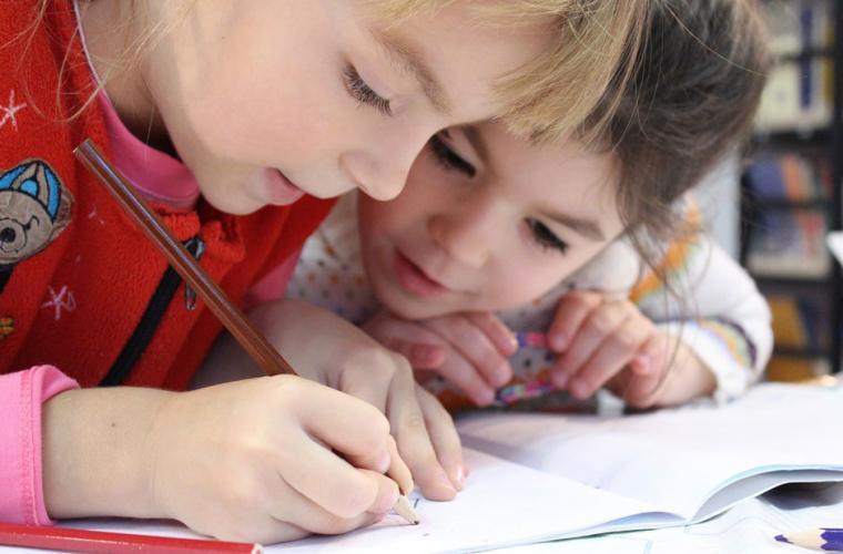 Boy and girl  writing