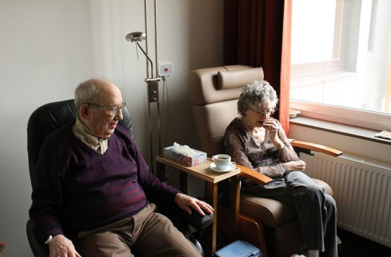 Couple sitting beside each other in hospital