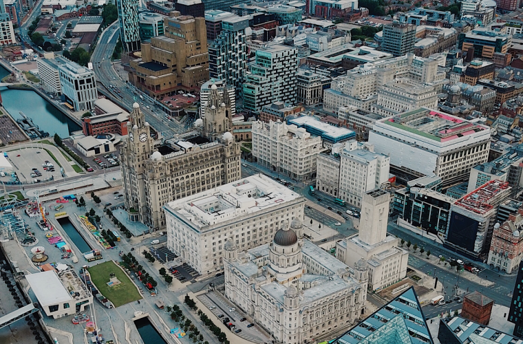 Ariel shot of Liverpool city centre and the water front including the liver buildings