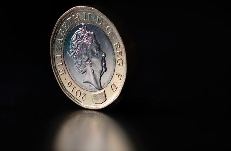 Pound coin on black background