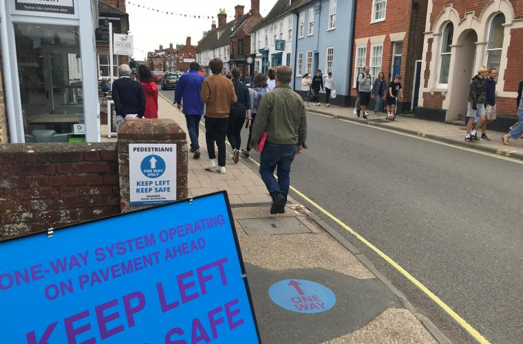 High street in East Suffolk with a few people walking through