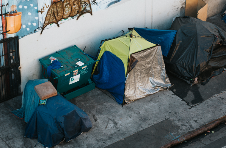 homeless tents lined up along the street