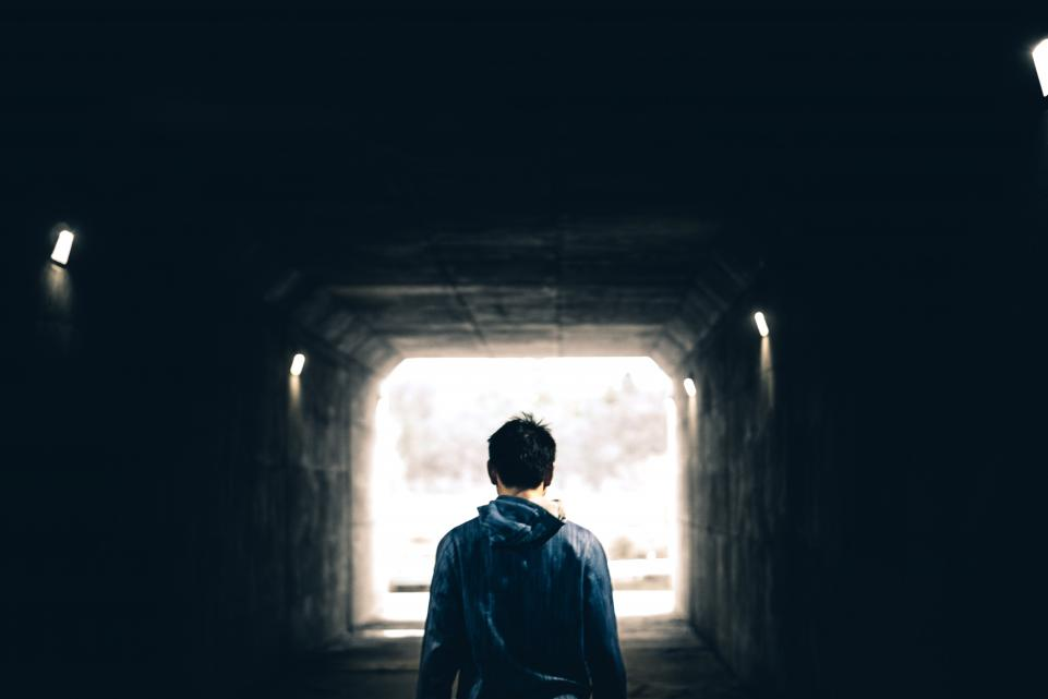 Young man in tunnel